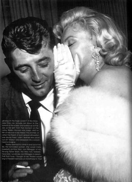 Marilyn y Mitchum confidencias