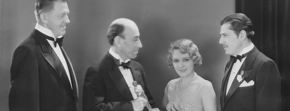 Hans Kraly, William C. de Mille, Mary Pickford, and Warner Baxter